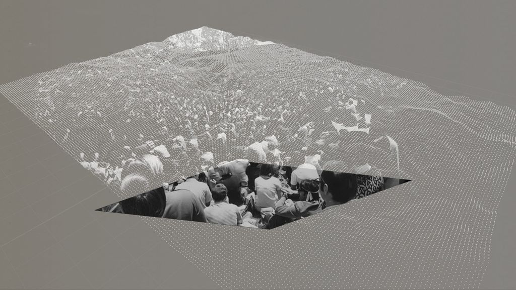 Black-and-white photo of people sitting at a protest, overlaid with grey and white dots
