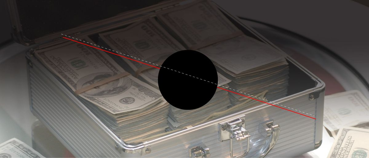 two lines crossing a black circle on a photo of grey metal case of hundred dollar bills