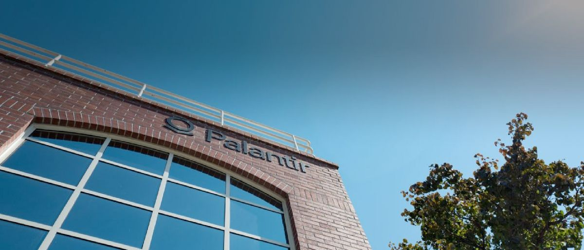 a view on a part of a brick house of Palantir headquarters and blue sky
