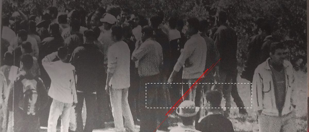 a part of a cover of the book (black and white photo of people standing backwards)
