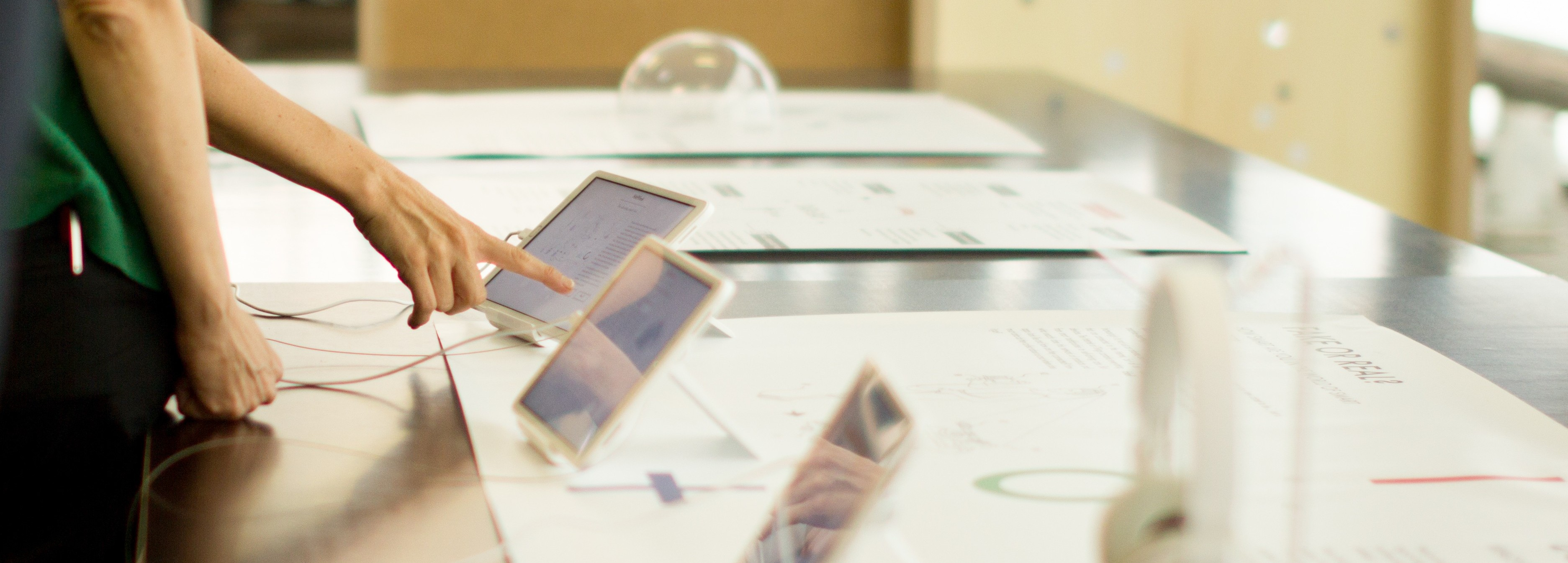 Tablets displayed at a Glass Room Community Edition event in Spain