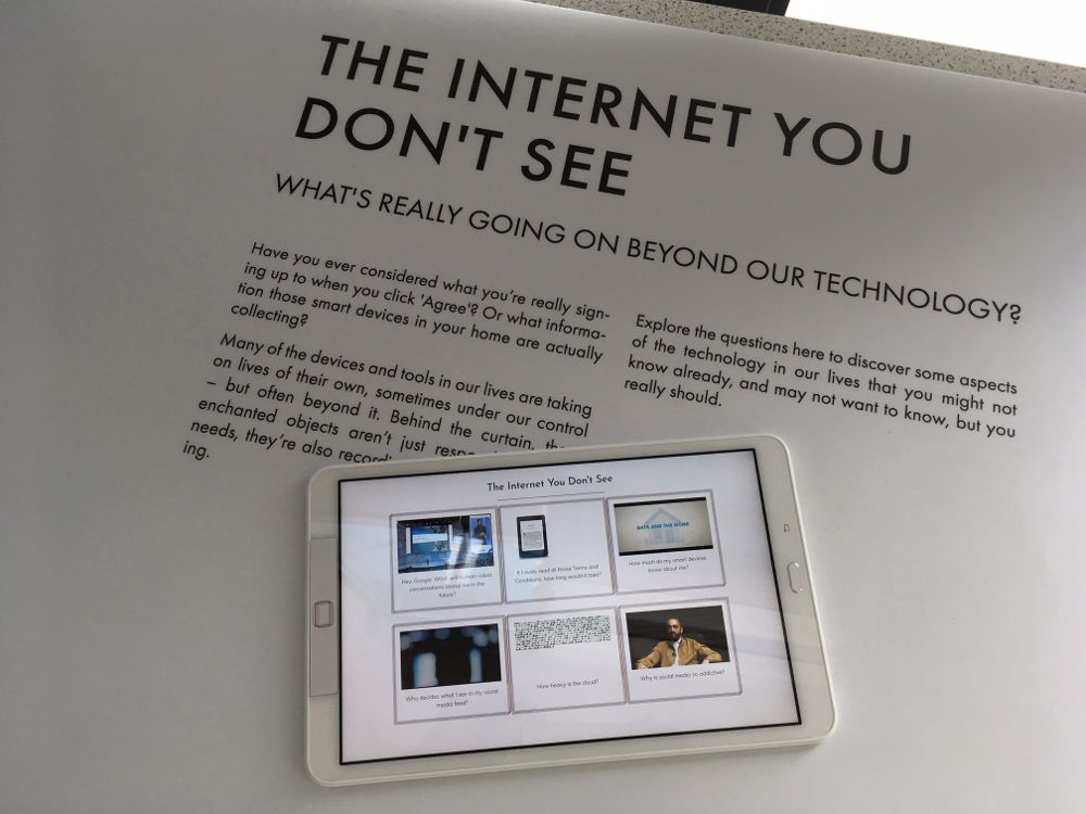 A tablet lying on a white background with text